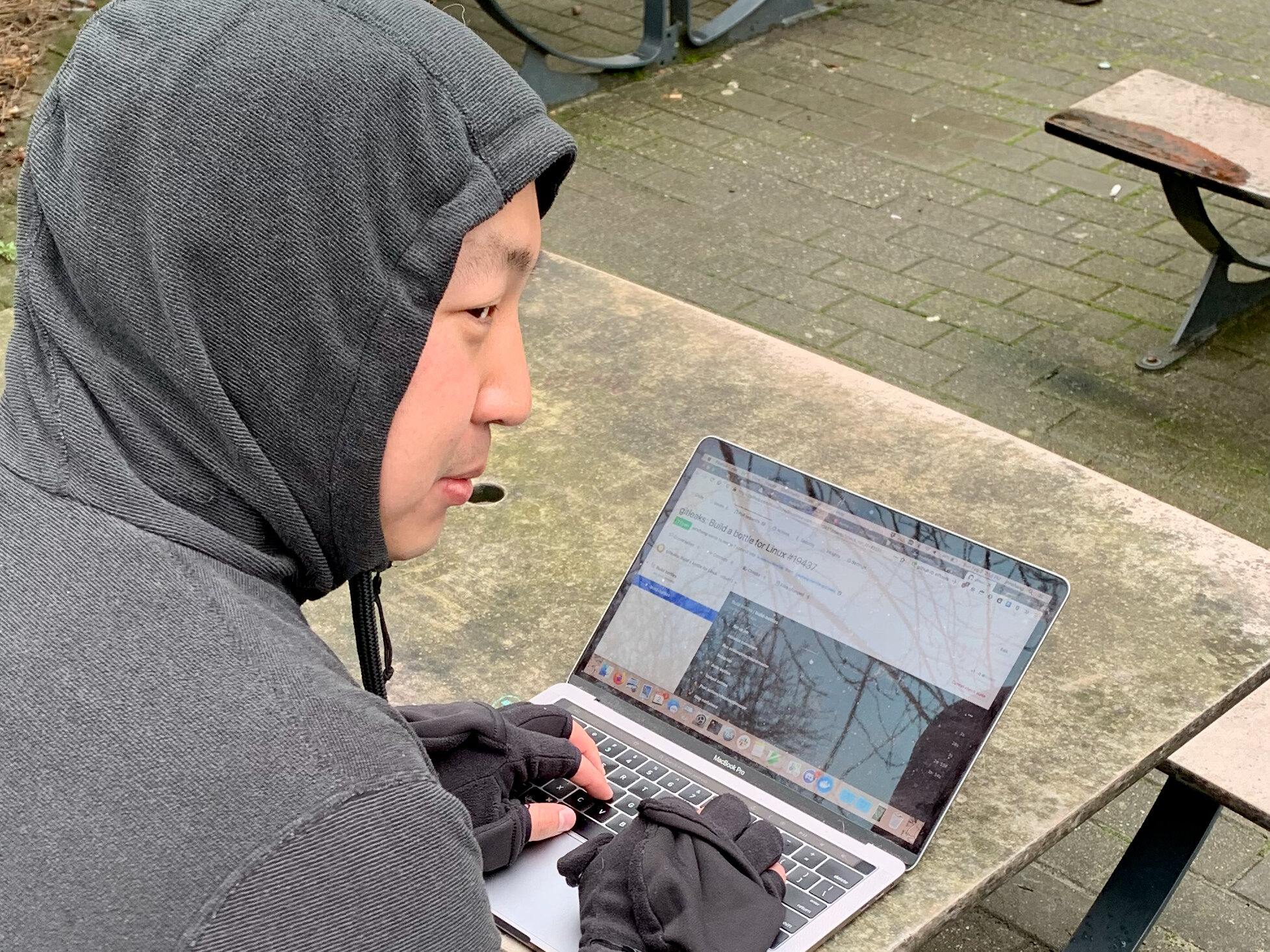 Jonathan hacking on continuous integration on his laptop outdoors in the cold.